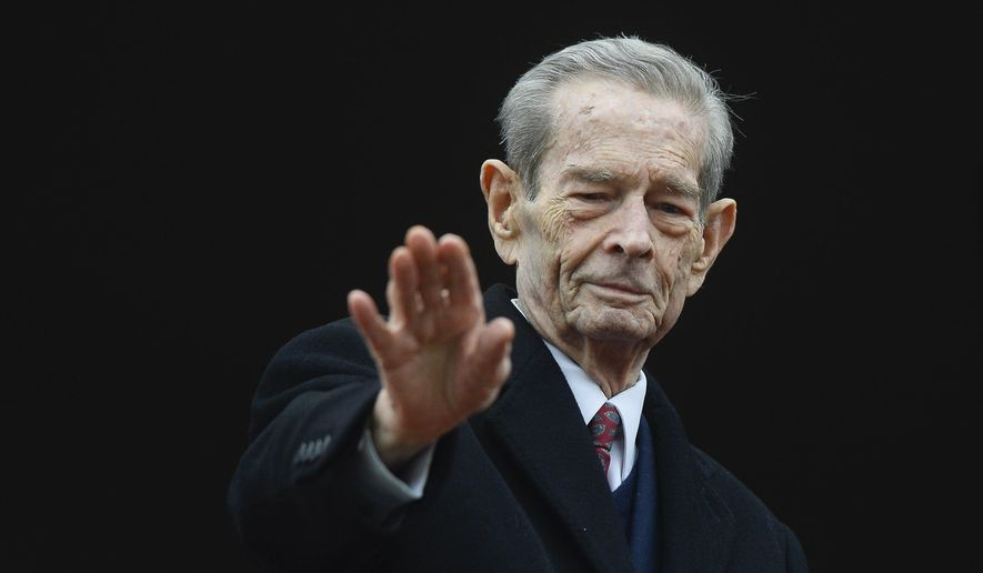 FILE - In this Wednesday, Nov. 19, 2014 file picture, Romania's former King Michael waves to supporters during an appearance at the Elisabeta Palace in Bucharest, Romania. Thousands of Romanians on Thursday Dec. 14, 2017 paid their respects to the late King Michael I whose coffin is lying in state at the Royal Palace before his funeral this weekend.Michael, who ruled Romania twice and was forced to abdicate by the communists in 1947, died Dec. 5 in Switzerland at age 96. (AP Photo/Octav Ganea, File)