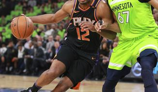 Phoenix Suns forward T.J. Warren (12) drives against Minnesota Timberwolves center Taj Gibson (67) in the first quarter of an NBA basketball game on Saturday, Dec. 16, 2017, in Minneapolis. (AP Photo/Andy Clayton-King)