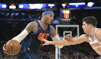 Oklahoma City Thunder forward Carmelo Anthony (7) holds off New York Knicks forward Doug McDermott (20) during the second quarter of an NBA basketball game Saturday, Dec.16, 2017, at Madison Square Garden in New York. (AP Photo/Bill Kostroun)