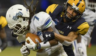West Florida wide receiver Antoine Griffin (7) is tackled by Texas A&M-Commerce defensive back Dominique Ramsey (17) during the first half of their NCAA Division II college football championship game in Kansas City, Kan., Saturday, Dec. 16, 2017. (AP Photo/Reed Hoffmann)