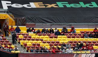 The announced paid attendance was 71,026, but empty seats filled the stands at FedEx Field to watch the Redskins beat the Cardinals on Sunday. (Associated Press)