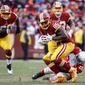 Washington Redskins tight end Vernon Davis (85) is stopped by Arizona Cardinals inside linebacker Deone Bucannon (20) during the second half of an NFL football game in Landover, Md., Sunday, Dec 17, 2017. (AP Photo/Patrick Semansky)