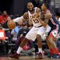 Cavaliers forward LeBron James had a triple-double in a 106-99 win over the Wizards on Sunday. Guard Bradley Beal scored 27. (Associated Press)