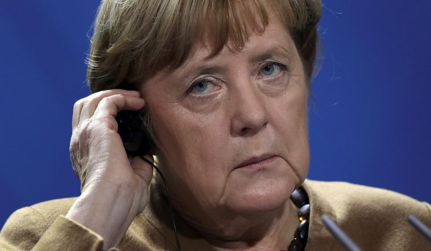 German Chancellor Angela Merkel's proposed coalition government could boost conservatives and far-right populists in the long run. (Associated Press/File)
