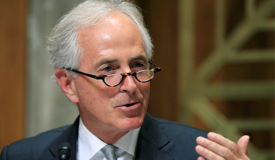 """Sen. Bob Corker, Tennessee Republican, voted against the tax bill last month but said he changed his mind """"after great thought and consideration."""" (Associated Press/File)"""