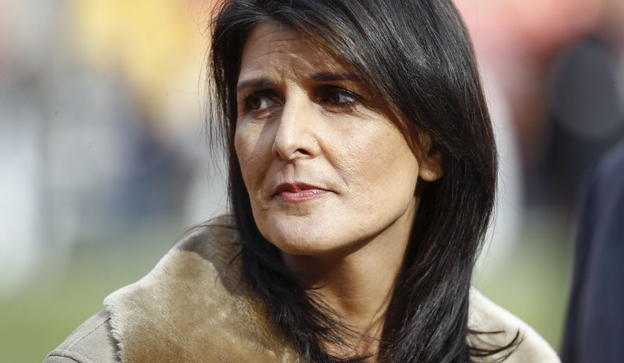 U.S. United Nations Ambassador Nikki Haley stands on the sidelines before an NFL football game between the Washington Redskins and the Arizona Cardinals in Landover, Md., Sunday, Dec 17, 2017. (AP Photo/Patrick Semansky)