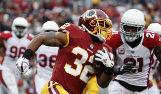 Washington Redskins running back Samaje Perine (32) carries the ball during the second half of an NFL football game against Arizona Cardinals in Landover, Md., Sunday, Dec 17, 2017. (AP Photo/Alex Brandon) **FILE**