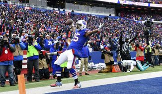 Buffalo Bills running back LeSean McCoy (25) celebrates after catching a pass for a touchdown during the first half of an NFL football game against the Miami Dolphins, Sunday, Dec. 17, 2017, in Orchard Park, N.Y. (AP Photo/Rich Barnes)