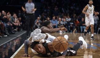 Indiana Pacers' Victor Oladipo, center top, competes for the ball with Brooklyn Nets' Rondae Hollis-Jefferson, bottom, during the second half of an NBA basketball game, Sunday, Dec. 17, 2017, in New York. (AP Photo/Andres Kudacki)