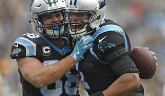 Carolina Panthers' Greg Olsen (88) celebrates his touchdown catch against the Green Bay Packers with Cam Newton (1) during the second half of an NFL football game in Charlotte, N.C., Sunday, Dec. 17, 2017. (AP Photo/Mike McCarn)