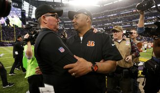 Cincinnati Bengals head coach Marvin Lewis, front right, talks with Minnesota Vikings head coach Mike Zimmer, left, after an NFL football game, Sunday, Dec. 17, 2017, in Minneapolis. (AP Photo/Bruce Kluckhohn)