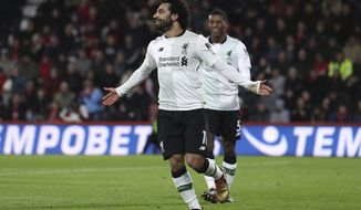 Liverpool's Mohamed Salah celebrates scoring his side's third goal against Bournemouth during the English Premier League soccer match at the Vitality Stadium in Bournemouth, England, Sunday Dec. 17, 2017. (Andrew Matthews/PA via AP)