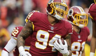 Washington Redskins outside linebacker Preston Smith (94) celebrates  after recovering a fumble by Arizona Cardinals quarterback Blaine Gabbert during the first half of an NFL football game in Landover, Md., Sunday, Dec. 17, 2017. (AP Photo/Mark Tenally) ** FILE **