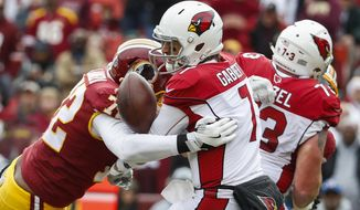 Washington Redskins defensive lineman Anthony Lanier (72) sacks Arizona Cardinals quarterback Blaine Gabbert (7), forcing a fumble and a turnover resulting in a Redskins touchdown during the first half of an NFL football game in Landover, Md., Sunday, Dec 17, 2017. (AP Photo/Alex Brandon)