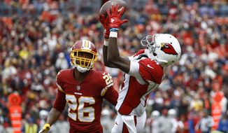 Arizona Cardinals wide receiver J.J. Nelson (14) pulls in a pass as Washington Redskins cornerback Bashaud Breeland (26) closes in during the first half of an NFL football game in Landover, Md., Sunday, Dec 17, 2017. (AP Photo/Patrick Semansky)