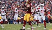 Washington Redskins wide receiver Jamison Crowder (80) pulls in a touchdown pass during the first half of an NFL football game against Arizona Cardinals in Landover, Md., Sunday, Dec 17, 2017. (AP Photo/Alex Brandon)