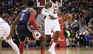 Cleveland Cavaliers forward LeBron James (23) dribbles against Washington Wizards guard John Wall (2) during the first half of an NBA basketball game, Sunday, Dec. 17, 2017, in Washington. (AP Photo/Nick Wass)