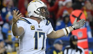 Los Angeles Chargers quarterback Philip Rivers (17) gestures during the second half of an NFL football game against the Kansas City Chiefs in Kansas City, Mo., Saturday, Dec. 16, 2017. The Chiefs won, 30-13. (AP Photo/Ed Zurga)