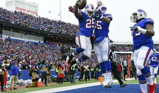 Buffalo Bills running back LeSean McCoy (25) celebrates with teammates Charles Clay (85) and Dion Dawkins (73) after catching a pass for a touchdown during the first half of an NFL football game against the Miami Dolphins, Sunday, Dec. 17, 2017, in Orchard Park, N.Y. (AP Photo/Rich Barnes)