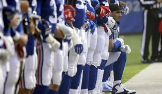 New York Giants defensive end Olivier Vernon, center right, takes a knee during the playing of the national anthem prior to an NFL football game against the Philadelphia Eagles, Sunday, Dec. 17, 2017, in East Rutherford, N.J. (AP Photo/Bill Kostroun)