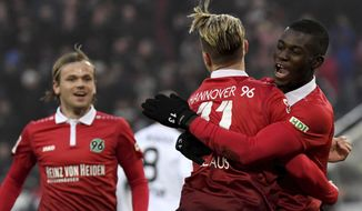 Hannover's Ihlas Bebou, right, and teammates Iver Fossum, left, and Felix Klaus celebrating Bebou's 1-1 equalizing goal, during the German Bundesliga soccer match between Hannover 96 and Bayer Leverkusen in Hannover, Germany, Sunday, Dec. 17, 2017.  (Peter Steffen/dpa via AP)