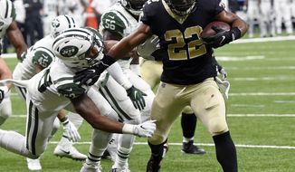 New Orleans Saints running back Mark Ingram (22) carries for a touchdown against New York Jets inside linebacker Darron Lee in the first half of an NFL football game in New Orleans, Sunday, Dec. 17, 2017. (AP Photo/Bill Feig)