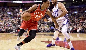 Toronto Raptors guard DeMar DeRozan (10) drives to the net as Sacramento Kings guard Garrett Temple (17) defends during first-half NBA basketball game action in Toronto, Sunday, Dec. 17, 2017. (Frank Gunn/The Canadian Press via AP)