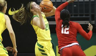 Oregon's Sabrina Ionescu, center, grabs a rebound to complete a triple-double at the end of third quarter during an NCAA college basketball game against Mississippi in Eugene, Ore., Sunday, Dec. 17, 2017. (Chris Pietsch/The Register-Guard)