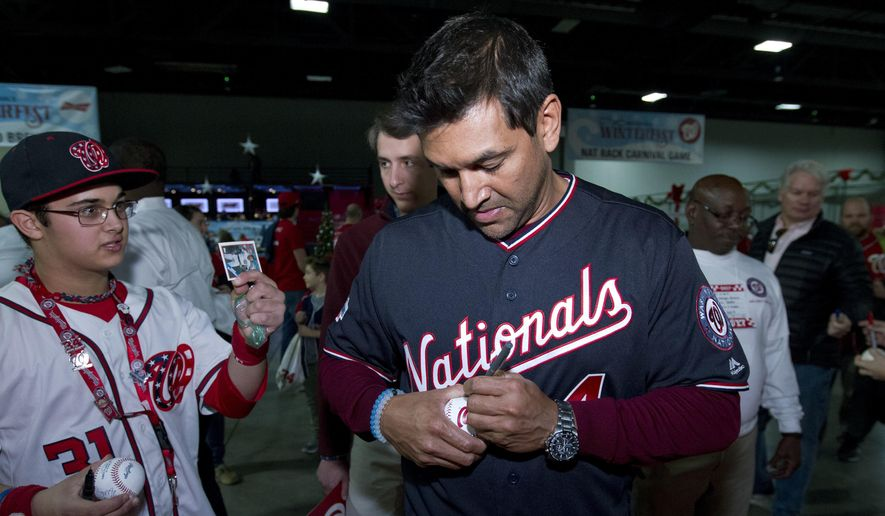 Washington Nationals Manager Dave Martinez sign autographs to children during the Winter Fest celebration with fans at Washington Convention Center in Washington, Saturday, Dec. 16, 2017. ( AP Photo/Jose Luis Magana) **FILE**