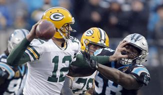 Green Bay Packers' Aaron Rodgers (12) blocks Carolina Panthers' Thomas Davis (58) during the second half of an NFL football game in Charlotte, N.C., Sunday, Dec. 17, 2017. (AP Photo/Bob Leverone) **FILE**