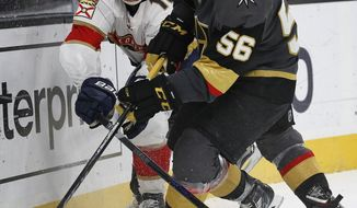 Vegas Golden Knights left wing Erik Haula, right, and Florida Panthers center Aleksander Barkov vie for the puck during the third period of an NHL hockey game, Sunday, Dec. 17, 2017, in Las Vegas. (AP Photo/John Locher)