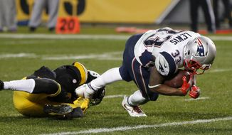 New England Patriots running back Dion Lewis (33) slips the tackle of Pittsburgh Steelers cornerback Artie Burns (25) and dives for the end zone for a touchdown during the second half of an NFL football game in Pittsburgh, Sunday, Dec. 17, 2017. The Patriots won 27-24. (AP Photo/Keith Srakocic)