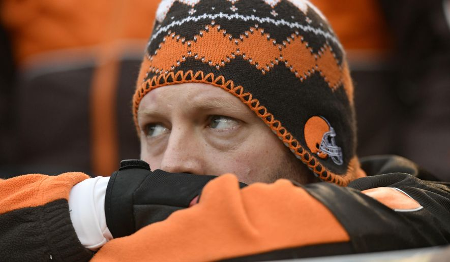 A Cleveland Browns fan watches during the second half of an NFL football game between the Baltimore Ravens and the Cleveland Browns, Sunday, Dec. 17, 2017, in Cleveland. (AP Photo/David Richard)