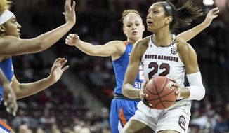 South Carolina forward A'ja Wilson (22) drives to the hoop against Savannah State center Sabree Gallishaw, left, during the first half of an NCAA college basketball game Sunday, Dec. 17, 2017, in Columbia, S.C. (AP Photo/Sean Rayford)