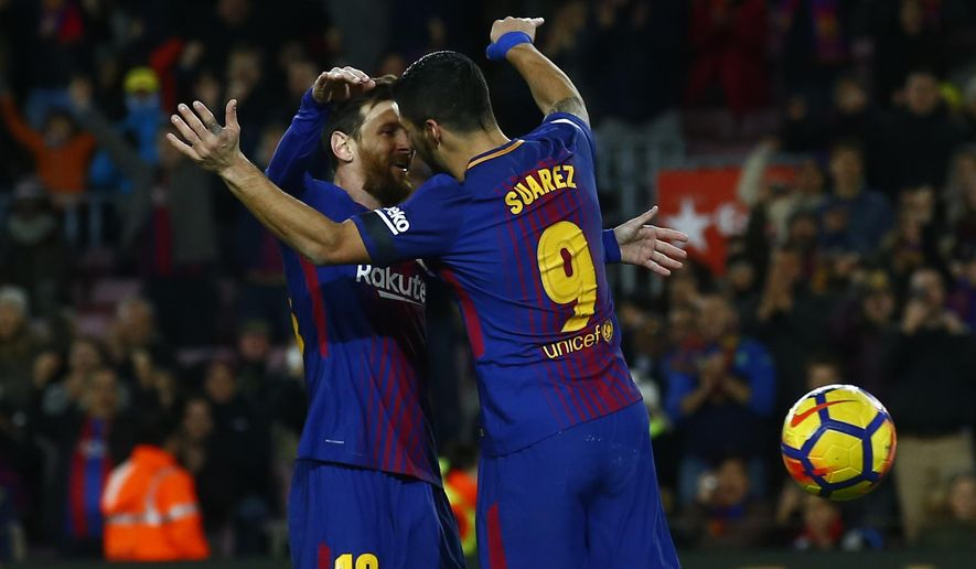 FC Barcelona's Luis Suarez, right, celebrates after scoring with his teammate Lionel Messi during the Spanish La Liga soccer match between FC Barcelona and Deportivo Coruna at the Camp Nou stadium in Barcelona, Spain, Sunday, Dec. 17, 2017. (AP Photo/Manu Fernandez)