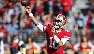 San Francisco 49ers quarterback Jimmy Garoppolo (10) throws against the Tennessee Titans during the first half of an NFL football game Sunday, Dec. 17, 2017, in Santa Clara, Calif. (AP Photo/John Hefti)