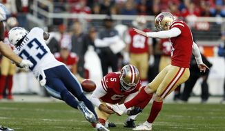San Francisco 49ers kicker Robbie Gould, right, kicks the game-winning field goal against the Tennessee Titans during the fourth quarter of an NFL football game, Sunday, Dec. 17, 2017, in Santa Clara, Calif. (AP Photo/D. Ross Cameron)