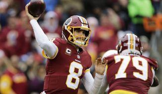 Washington Redskins quarterback Kirk Cousins (8) throws the ball during an NFL football game against the Arizona Cardinals, Sunday, Dec. 17, 2017, in Landover, Md. (AP Photo/Mark Tenally)