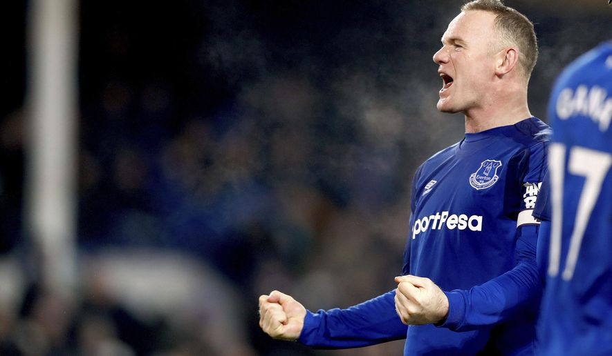 Everton's Wayne Rooney celebrates scoring his side's third goal of the game from the penalty spot during their English Premier League soccer match Everton versus Swansea City at Goodison Park, Liverpool, England, Monday, Dec. 18, 2017. (Martin Rickett/PA via AP)