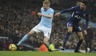 Manchester City's Kevin De Bruyne, left, and Tottenham's Dele Alli battle for the ball during the English Premier League soccer match between Manchester City and Tottenham Hotspur at Etihad stadium, in Manchester, England, Saturday, Dec. 16, 2017. (AP Photo/Rui Vieira)