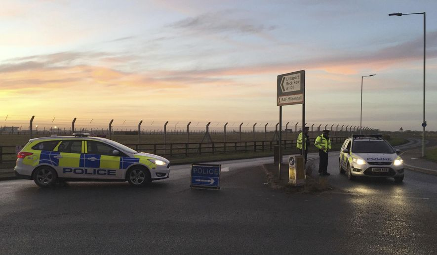 British police secure the area outside RAF Mildenhall, England, an incident and a suspect was arrested after a disturbance at the base, Monday Dec. 18, 2017.  The Midenhall airbase, about 80 miles (130 kilometers) north of London, is used by the U.S. Air Force, and was briefly locked down and a man was taken into custody after a disturbance Monday, police said.  (Sam Russell/PA via AP)