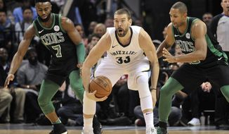 Memphis Grizzlies center Marc Gasol (33) controls the ball between Boston Celtics guard Jaylen Brown (7) and forward Al Horford, right, in the first half of an NBA basketball game Saturday, Dec. 16, 2017, in Memphis, Tenn. (AP Photo/Brandon Dill)