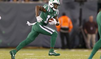 FILE - This Nov. 2, 2017 file photo shows New York Jets' Jeremy Kerley (14) running with the ball against the Buffalo Bills during the first half of an NFL football game in East Rutherford, N.J. The Jets have waived Kerley, who had been on a one-week roster exemption following a four-game suspension for violating the NFL's policy on performance enhancers. The Jets had until 4 p.m. EST on Monday, Dec. 18, 2017 to either cut Kerley or make a roster move to clear a spot for the wide receiver. (AP Photo/Kathy Willens)