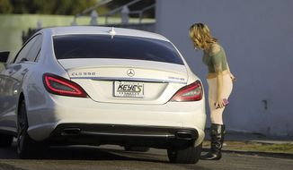 In this Wednesday, Nov. 15, 2017 photo, an undercover sheriff's deputy talks to a man who pulled over to talk with her in Compton, Calif., a city some 15 miles south of Los Angeles.  (AP Photo/Reed Saxon) **FILE**
