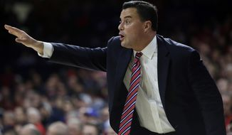 Arizona head coach Sean Miller yells to his team in the first half during an NCAA college basketball game against North Dakota State, Monday, Dec 18, 2017, in Tucson, Ariz. (AP Photo/Rick Scuteri)