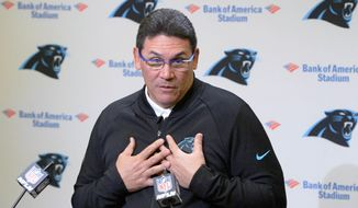 Carolina Panthers NFL football head coach Ron Rivera  answers a question about the allegations against team owner Jerry Richardson, and the announced sale of the team at the end of the season, during a weekly press conference at Bank of America Stadium in Charlotte, N.C., Monday, Dec. 18, 2017. (David T. Frost III/The Charlotte Observer via AP)