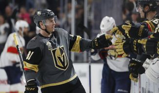 Vegas Golden Knights center Jonathan Marchessault celebrates with teammates after scoring against the Florida Panthers during the third period of an NHL hockey game Sunday, Dec. 17, 2017, in Las Vegas. (AP Photo/John Locher)