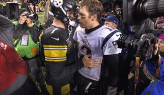 Pittsburgh Steelers quarterback Ben Roethlisberger (7) and New England Patriots quarterback Tom Brady (12) meet on the field following an NFL football game in Pittsburgh, Sunday, Dec. 17, 2017.(AP Photo/Don Wright)