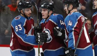 Colorado Avalanche defenseman Tyson Barrie, center, is congratulated by left wingers Matt Nieto and Blake Comeau after scoring a goal against the Pittsburgh Penguins in the first period of an NHL hockey game Monday, Dec. 18, 2017, in Denver. (AP Photo/David Zalubowski)