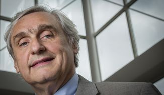 FILE - In this July 24, 2014, file photo, then-Chief Judge of the U.S. Court of Appeals for the Ninth Circuit Alex Kozinski poses for a portrait in the lobby of a Washington office building. The Washington Post says nine more women say they were subject to inappropriate sexual conduct or comments by a prominent U.S. appeals court judge. In a story published on Friday, Dec. 15, 2017, the newspaper says the latest allegations against 9th U.S. Circuit Court of Appeals Judge Kozinski go back decades and include women who met him at events. (AP Photo/J. David Ake, File)